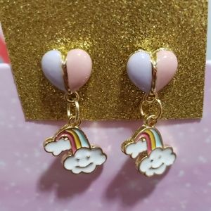 Pink and purple heart studs with rainbow charms.